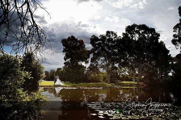 Wedding photograph at the pond at Brown Brothers Winery Milawa by Stephen Jorgensen from All Saints Photography Albury.