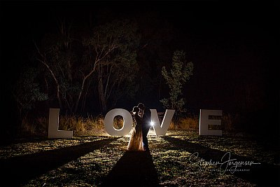 Wedding photograph at night in front of love letters by Stephen Jorgensen from All Saints Photography Albury.